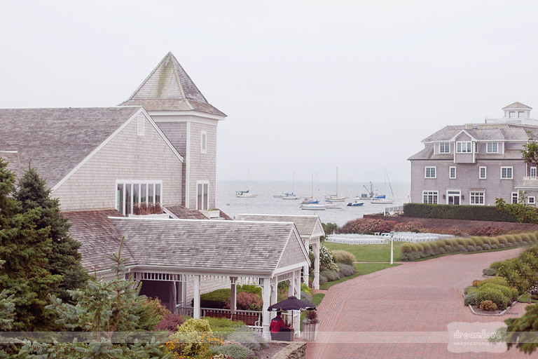 Scenic view of the Wychmere Beach Club, sailboats, and the ocean for a Cape Cod wedding.