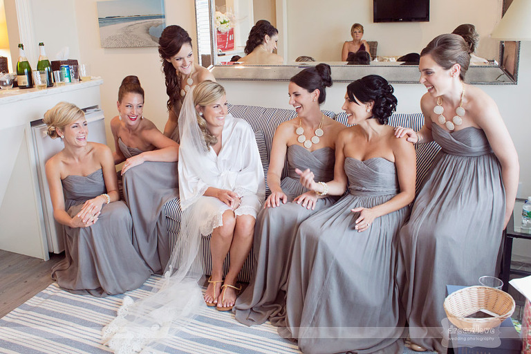 Laughing bridesmaids surround a bride before a Wychmere Beach Club Wedding.