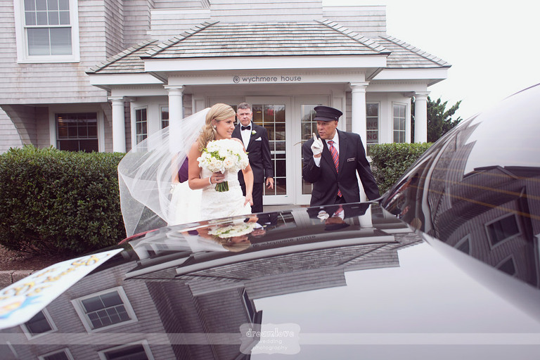 A bride is reflected against a limo outside of the Wychmere house in Harwich, MA.