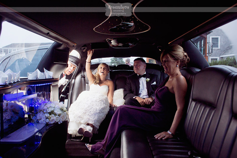 The bride and her parents inside of a limo.