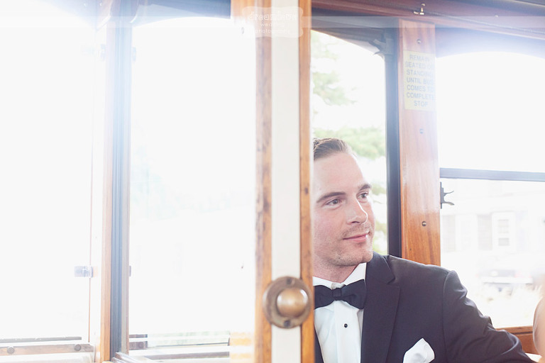Groom rides to his wedding on a vintage trolly.
