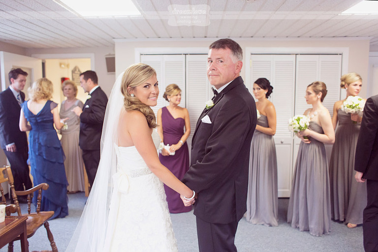 A bride and her father prior to walking down the aisle.