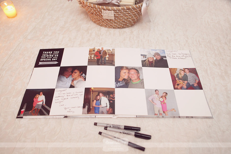 Guests sign a guestbook that features images of the couple.
