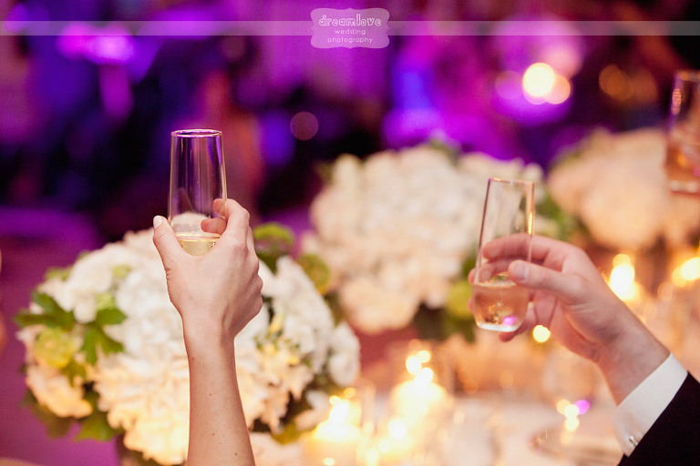 Detail of the champagne glasses during wedding toasts.