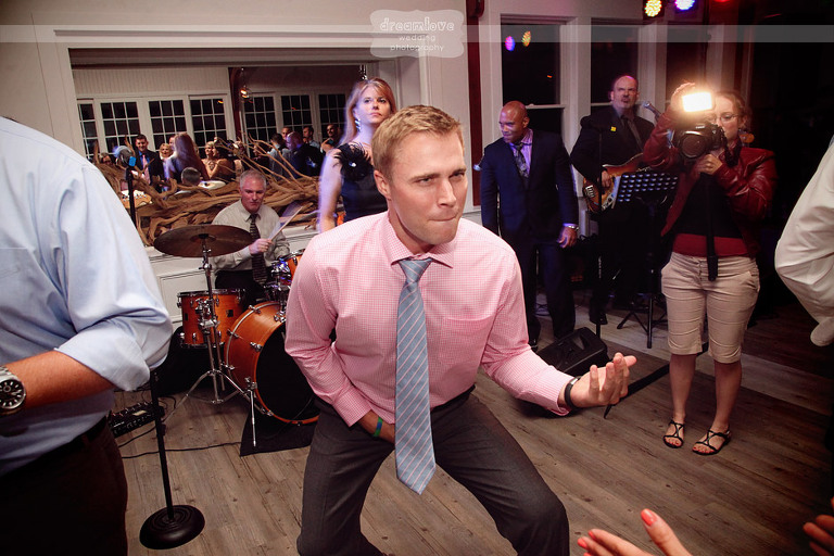 A guest plays the air guitar during a wedding reception at the Wychmere.