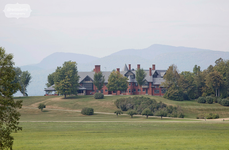 view of the shelburne farms wedding estate venue with mountains behind it