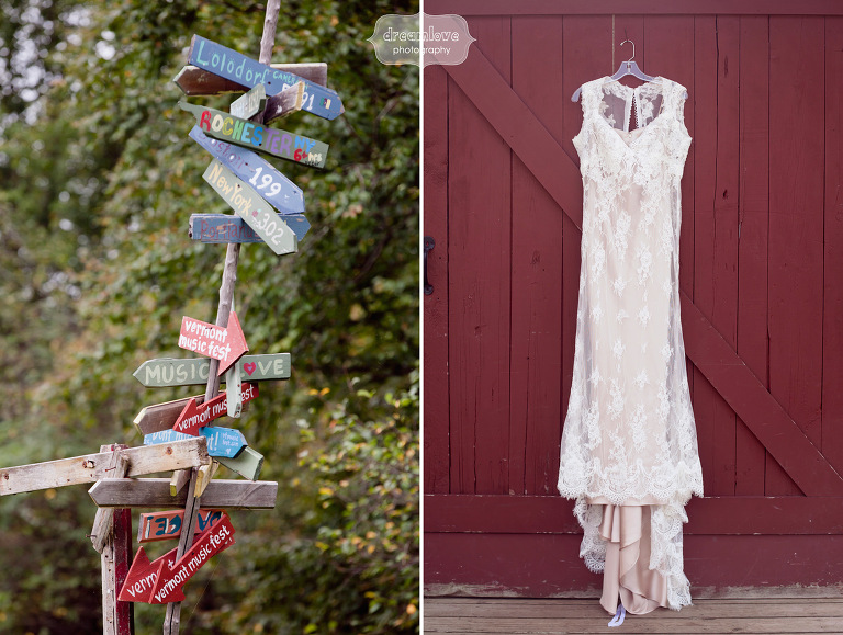 A lace wedding dress hung up against a red barn wall in Vermont.