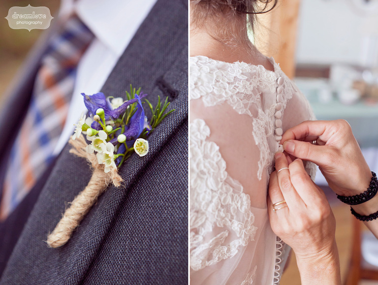 Detail photograph of a groom's boutonniere and a bride's dress being buttoned up.