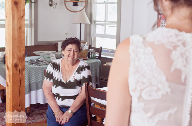 An emotional mother-in-law reacts to seeing a bride all dressed up on her wedding day.