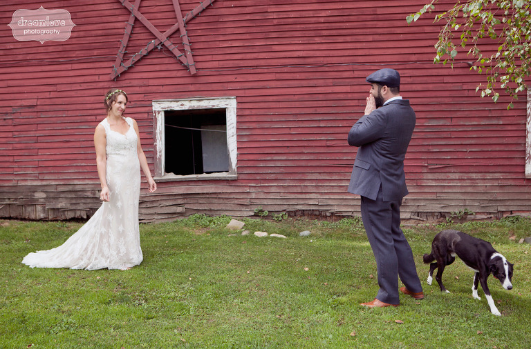 A bride and groom react to seeing each other for the first time before their wedding at the Lareau Farm Inn. They even included their dog in the first look!