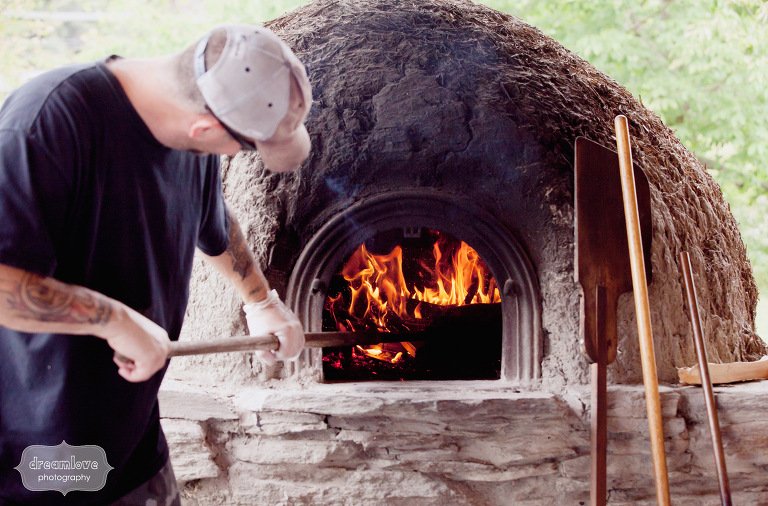 A wood fired oven cooks pizza for a wedding dinner at the Lareau Farm Inn.