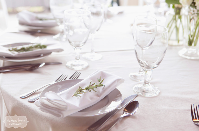 Sprigs of rosemary placed on top of napkins were part of the wedding reception decor.