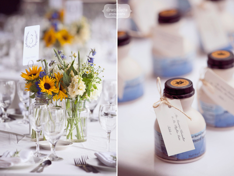 Fall inspired floral arrangements and maple syrup wedding favors at a Vermont wedding.