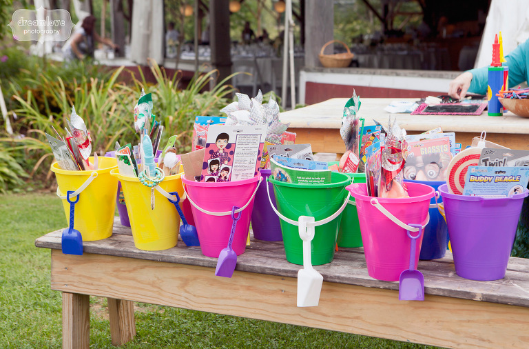 Buckets of toys and activities kept they children entertained at this non traditional outdoor wedding.