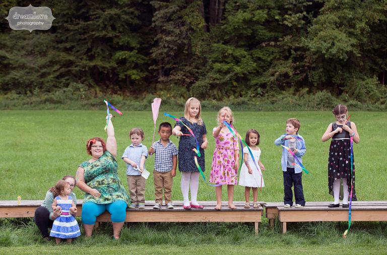 Children way flags at an outdoor wedding reception in Vermont.
