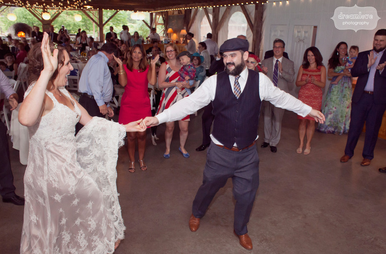 A bride and groom share their first dance under the pavilion at the Lareau Farm Inn.