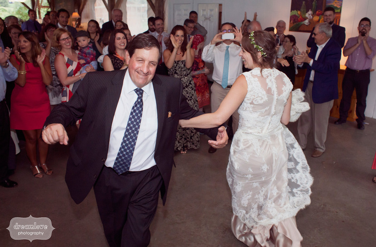 A happy father and daughter dance at a wedding reception in Vermont.