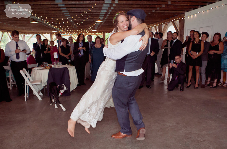 A groom swings his smiling, barefoot bride around the dance floor during the couples first dance at the Lareau Farm Inn.