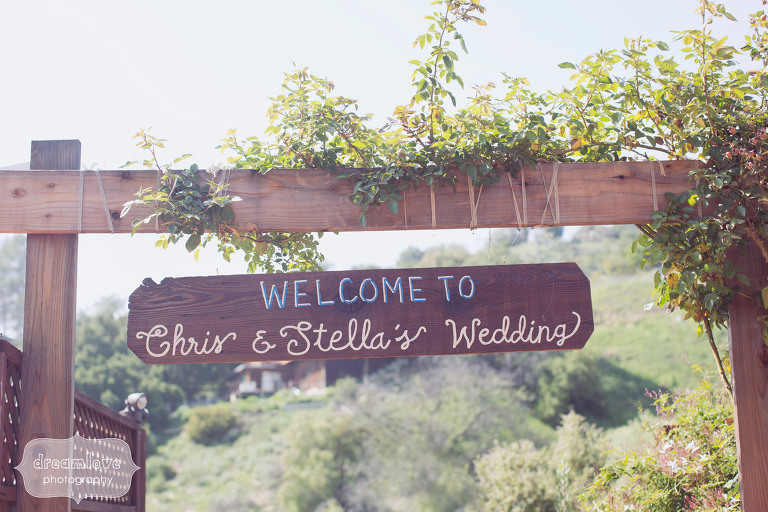 """Handmade wooden wedding sign at the 1909 that says, """"Welcome to Chris and Stella's Wedding"""""""