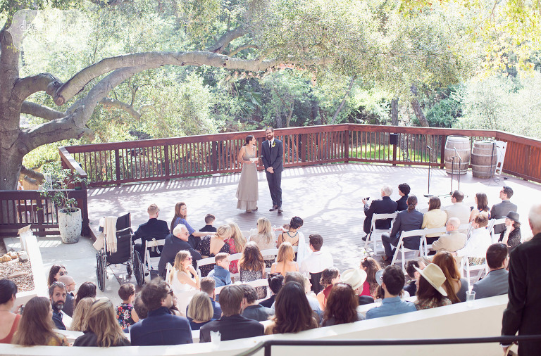 View of the outdoor deck at the 1909 wedding venue in Topanga Canyon, CA for a spring wedding.