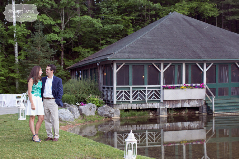 Bride and groom to be stand outside of the Equinox Pond Pavilion building before rehearsal dinner.