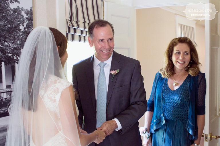 Documentary photo of father seeing daughter for the first time on wedding day at the Equinox Resort in VT.
