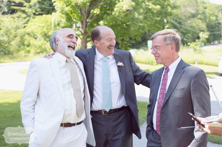 Great candid wedding photo of the father of the groom with friends at the Hildene in Manchester, VT.