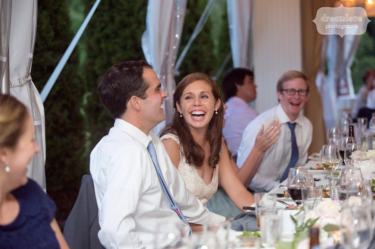 Documentary photo of the bride laughing during the maid of honor speech at the Hildene in VT.