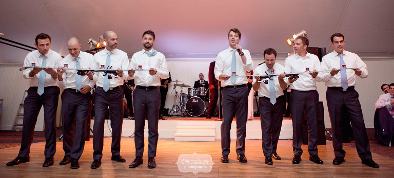 Photo of the groomsmen doing a ski shot in front of wedding guests during speeches at the Hildene in VT.