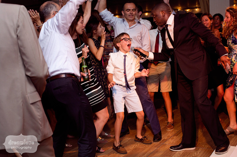 Best wedding photo of the band K2 singing with a kid at the wedding reception at the Hildene in VT.
