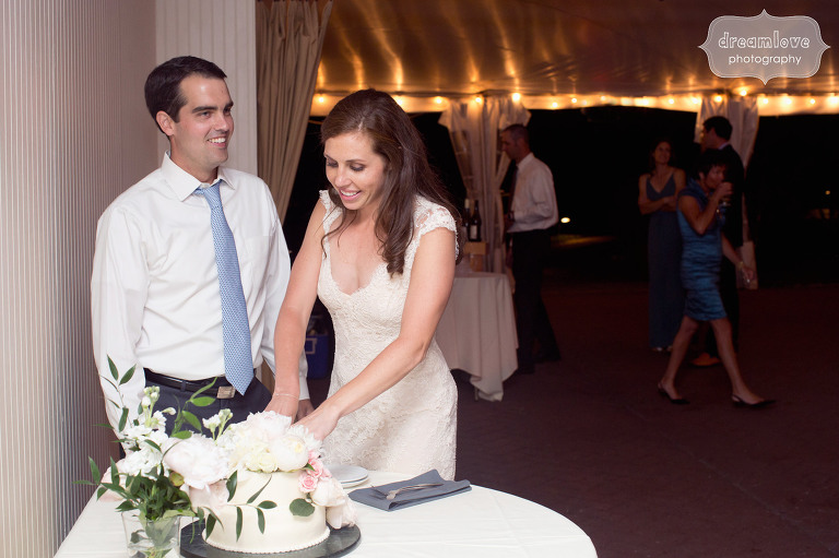 Bride and groom cut the cake during the wedding reception at the Hildene.