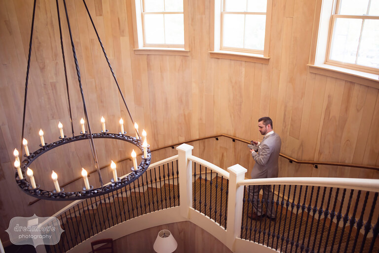 Groom walks down the staircase at the Sugarbush Resort in VT.