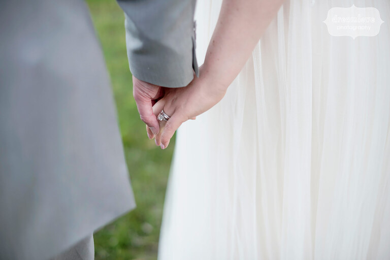 Bride and groom hold hands during their June wedding at Sugarbush in VT.