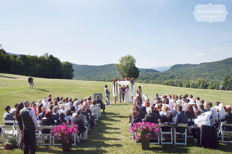 An outdoor June wedding ceremony at the Sugarbush Resort in VT.