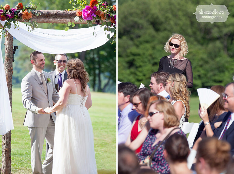 Photo of the bride and groom during their wedding ceremony with Jewish chuppah at Sugarbush, VT.