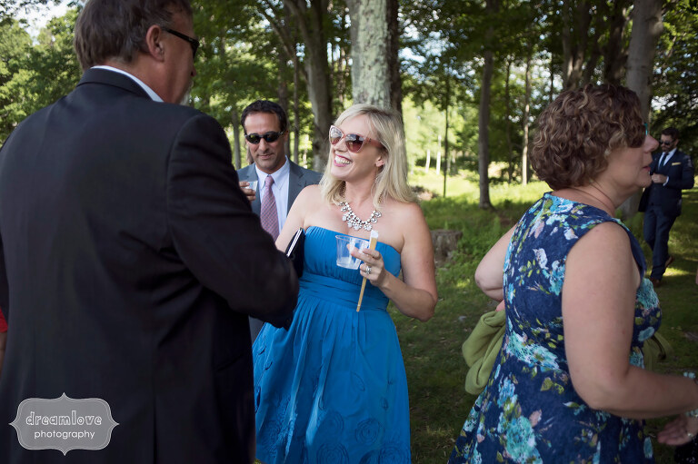 Wedding guests mingle before the outdoor ceremony at Sugarbush in VT.