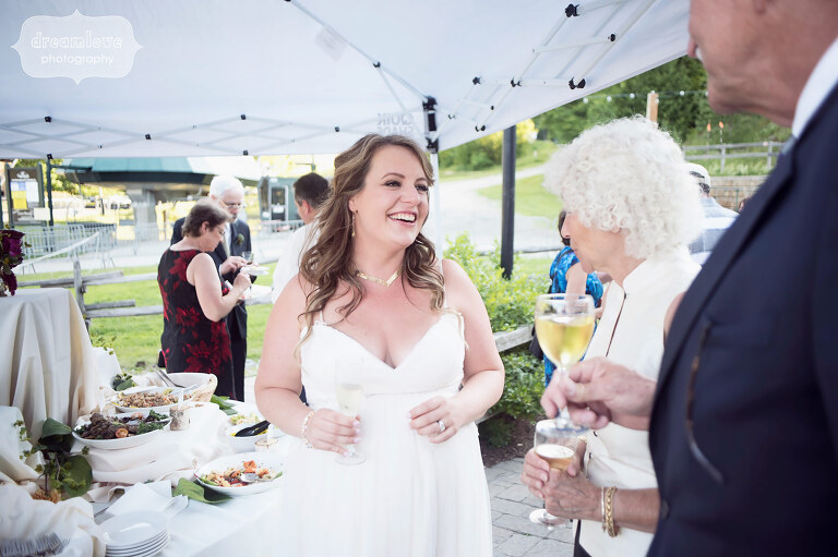 The bride talking with a guest at her Sugarbush, VT wedding in June.