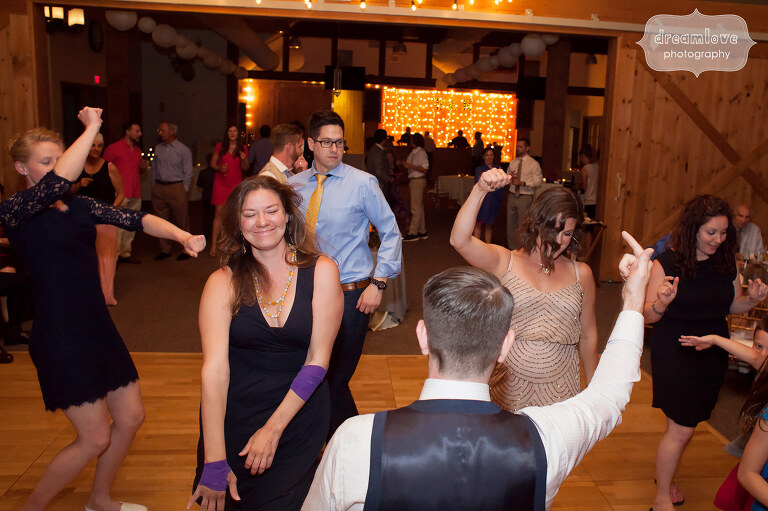 Wedding guests dancing during the reception at the Sugarbush Resort in VT.