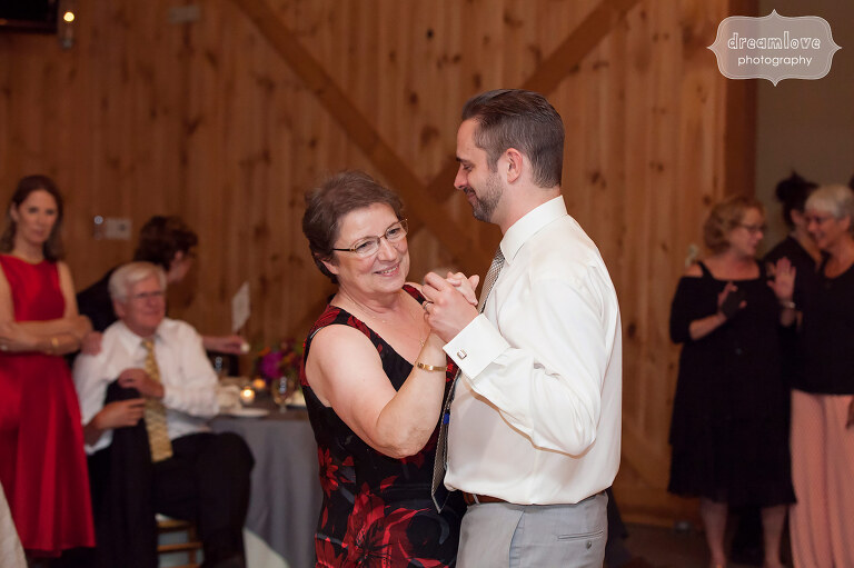 The mother of the groom dances with her son at this Sugarbush VT wedding reception.