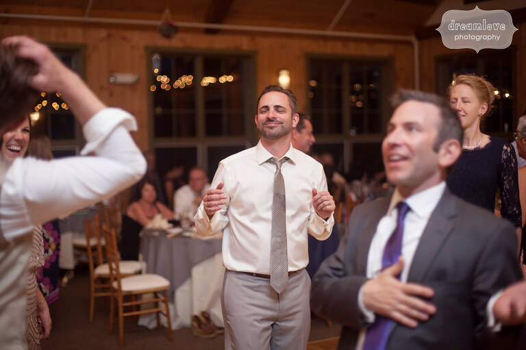 The groom pulls out some funny dance moves during his wedding reception at the Sugarbush Resort in VT.