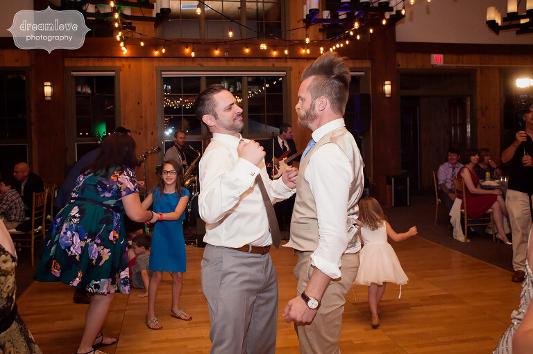 The groom and his friends dance during their rustic wedding reception in Sugarbush, VT.
