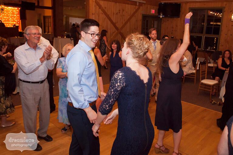 Wedding guests dance in the barn at the reception at Sugarbush, VT.