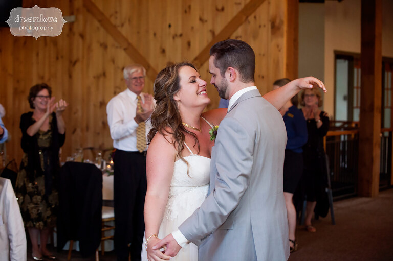 Documentary photography of bride and groom's first dance at the Sugarbush Resort in VT for their summer wedding.