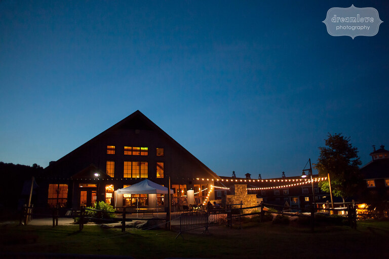 Beautiful view of the Sugarbush Resort barn at night for a rustic wedding reception in VT.