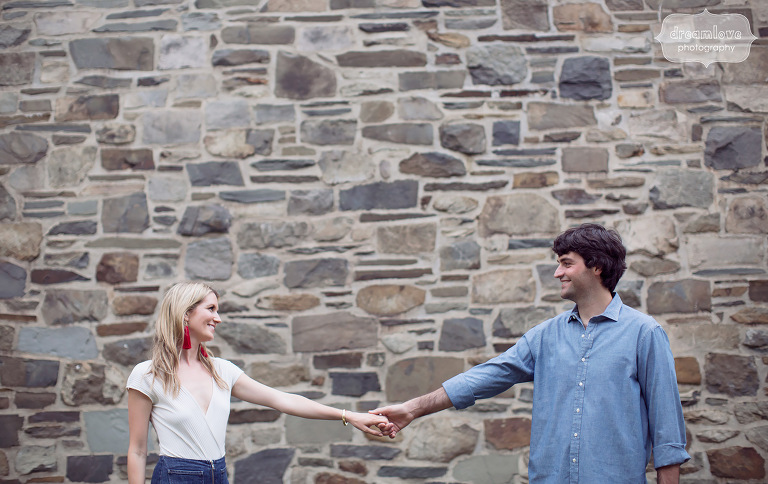 Couple with stone wall for Anthropologie engagement photography session in Hudson Valley, NY.