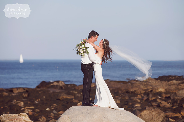 Bride and groom on the rocks at Odiorne State Park in NH.