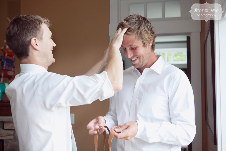 Candid photo of the groom getting ready with her groomsmen at the 1824 House wedding venue in VT.