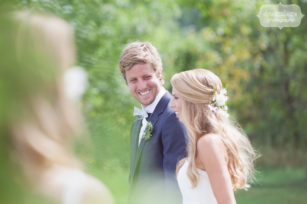 Great candid wedding photo of the groom looking at the bride during their wedding ceremony at the 1824 House in Waitsfield, VT.