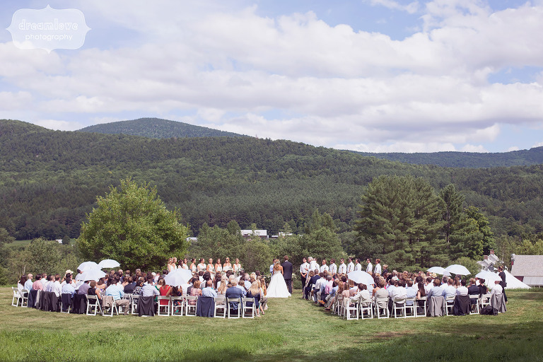 View of the outdoor ceremony with scenic green mountains at the 1824 House in the Mad River Valley of VT.