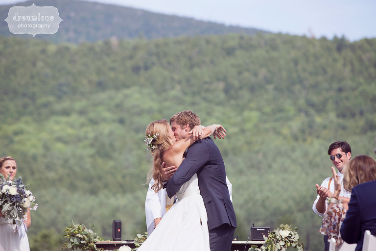 Photo of the bride and groom kissing at the end of their summer ceremony at the 1824 House in VT.